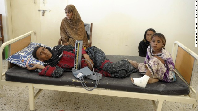 Pakistani survivors take shelter at a makeshift hospital in the earthquake-devastated district of Awaran on Wednesday, September 25. The 7.7-magnitude quake struck on September 24 in a remote, sparsely populated area of southwestern Pakistan.
