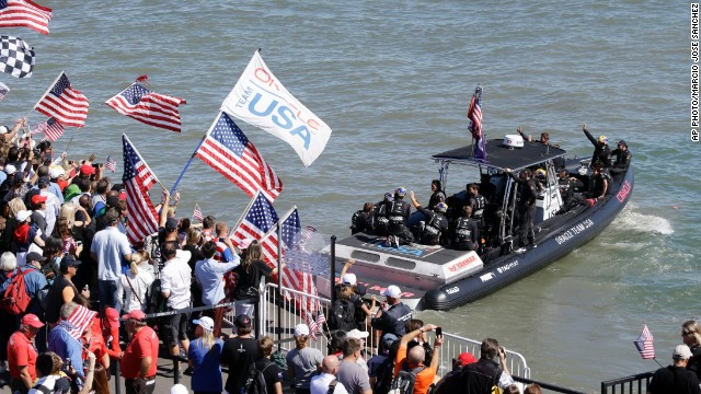 Oracle Team USA was given a huge ovation by the home crowd as its team members boarded the ferry. Supporters flocked to watch with the prospect of history being made.