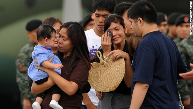 The wife of a soldier killed in the rebel attack in Zamboanga cries as the coffin carrying her husband arrives at Villamor airbase in Manila on September 25.