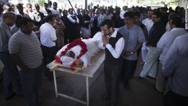 Mourners on Thursday, September 26, observe the body of Sridhar Natarajan, who was killed during the Westgate Shopping Mall attack in Nairobi, Kenya.