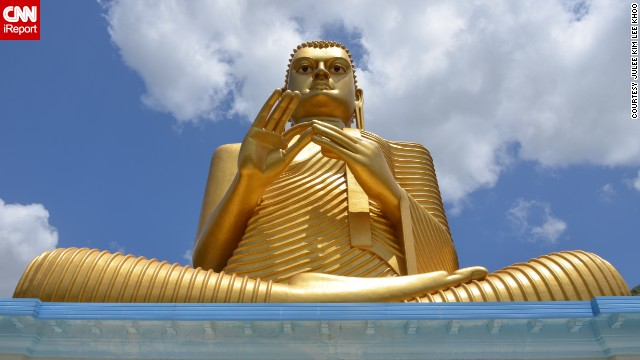 This large, golden Buddha statue is part of the Dambulla Temple Complex, which is one of Sri Lanka's heritage landmarks. These temples celebrate Buddha and former Sri Lankan kings.