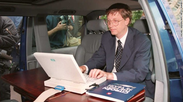 Microsoft president Bill Gates demonstrates Microsoft's Windows 95 program from his automobile prior to a press conference in Paris in September 1994.