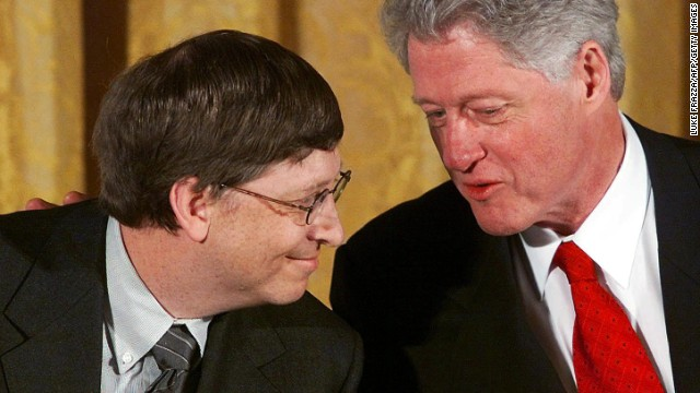 "Gates and former US President Bill Clinton attend a White House conference on ""the New Economy"" in April 2000."
