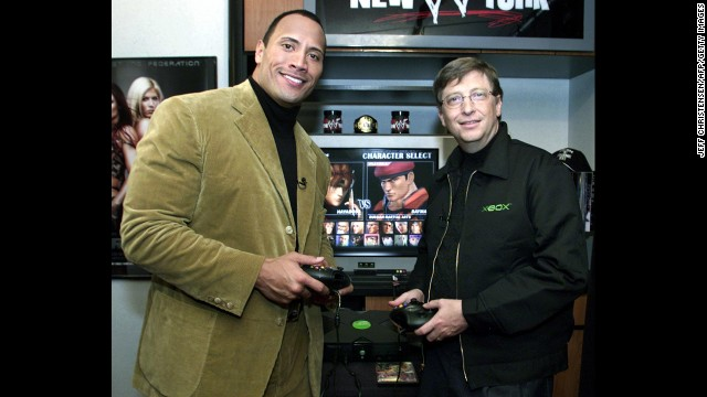 "Gates plays an Xbox game with World Wrestling Federation (now WWE) star Duane ""The Rock"" Johnson in 2001 at the gaming console's launch."