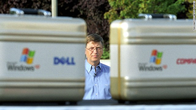 Gates waits to go onstage at the release of the Windows XP operating system August 24, 2001 in Redmond, Washington.