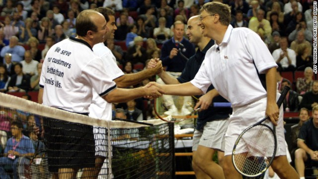 Tennis greats Andre Agassi and Pete Sampras shake hands at the net, as Gates and Amazon founder Jeff Bezos do the same, at a celebrity match in Seattle in 2001.