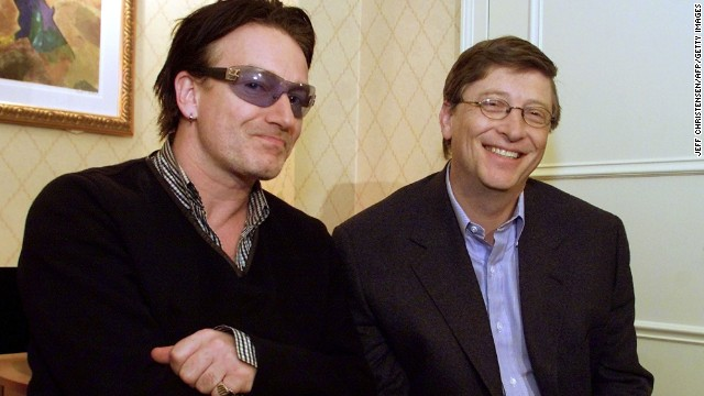 U2 frontman Bono and Gates sit together before a news conference at the World Economic Forum in New York, in February, 2002.
