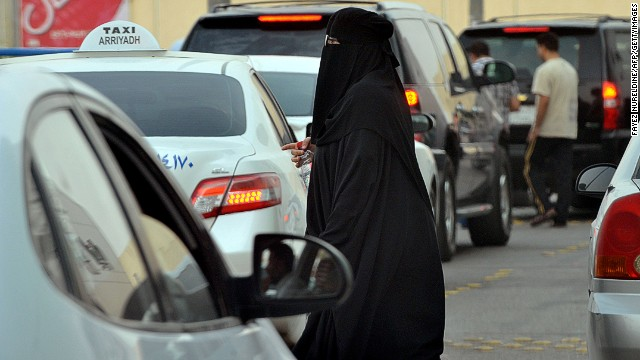 A Saudi woman waits for a taxi outside a shopping mall in Riyadh on June 22, 2012.