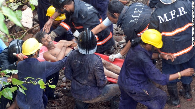 Rescuers pull a man from the rubble while the search continues for survivors.