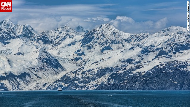 "Randy Lathrop shot this photo of Alaska's ""majestic mountains"" from a cruise ship in Glacier Bay. He felt like the ship was ""dwarfed"" by the snow-capped peaks."