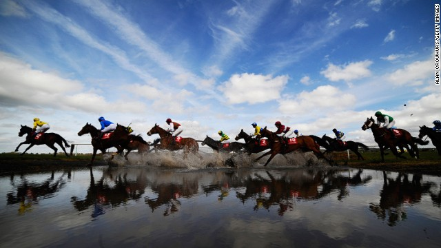 "Punchestown, Ireland: Runners make their way through ""Joe's Water Splash'""at Punchestown racecourse in April."