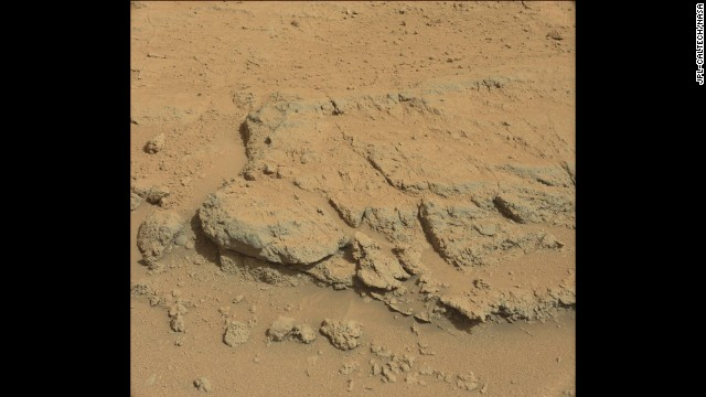 "The Curiosity rover took this image on September 10 of a rock formation informally dubbed ""Darwin,"" first noted from the orbiting spacecraft. Scientists had the rover stop in this region, called Waypoint 1, because it appears to be a prime area to study the inner makeup and history of the floor of the Gale Crater. Analysis of Darwin may provide evidence of whether and how water played a role in the layering of rocks in this region."
