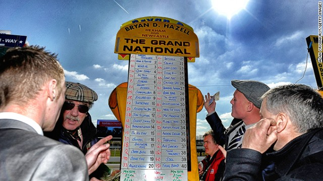 The Grand National, Aintree, Liverpool, UK: A bookmaker taking bets on the Grand National in April. The first official running of the world's most famous handicap steeplechase took place in 1839.