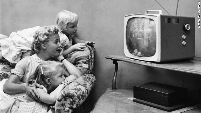 A family watching television in their home, circa 1955. The channels we've always known are the perfect interface for TV.