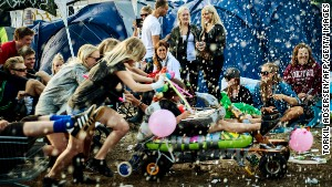 Life isn\'t always a party in Denmark, but people are happy anyway, like these at the Roskilde festival.