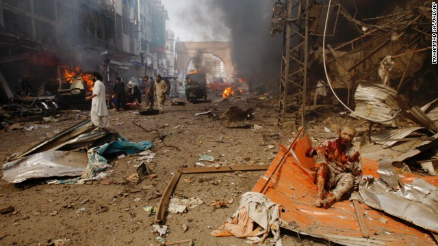 An injured man waits for help at the site of the blast.