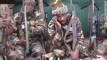 A screengrab taken on September 25, 2013 from a video distributed through an intermediary to local reporters and seen by AFP, shows a man claiming to be the leader of Nigerian Islamist extremist group Boko Haram Abubakar Shekau. The video, which comes after an outburst of violence in northeastern Nigeria, shows the man taunting world leaders after the military said he may have been killed. RESTRICTED TO EDITORIAL USE - MANDATORY CREDIT