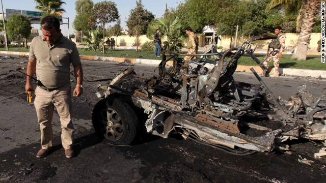 A member of the Iraqi Kurdish security forces inspects the site of a car bomb in Arbil on Sunday.