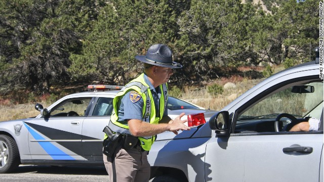 A Colorado State trooper tells a driver Monday that the road is closed after a rock slide at Agnes Vaille Falls.