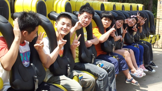 From feeding out of dustbins and frequent beatings, to the joy of an amusement park trip in China, the group was given hope of a better life.