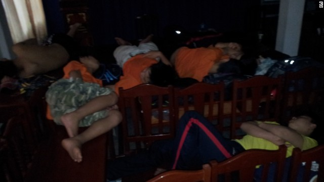 But their world came crashing down shortly after they crossed into Laos illegally on May 10, when they were caught by police without papers. Here they sleep at the detention center they were taken to.