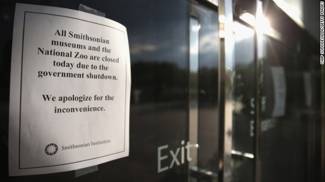 Signs taped on museum doors warning visitors that the National Museum of American History in Washington is sealed on Oct 1.