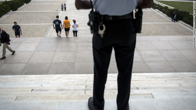 A U.S. park use military officer stands ensure at the opening of the sealed Lincoln Memorial on Oct 1.