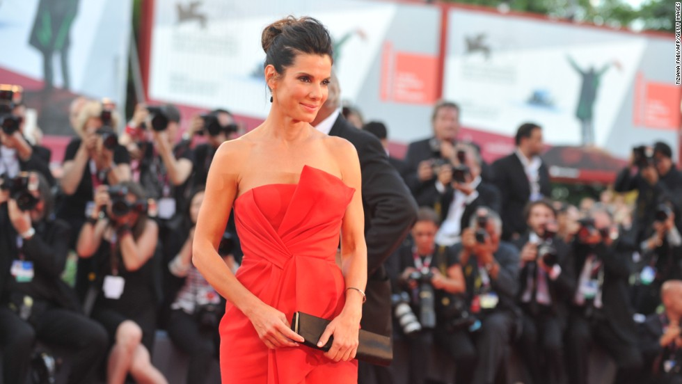 "Sandra Bullock is once again riding high with Oscar buzz, this time for her performance the new film ""Gravity"" (out October 4). Here she arrives for the opening ceremony of the 70th Venice Film Festival and the screening of the movie at the competition in August. It's been a charmed life and career for the actress..."