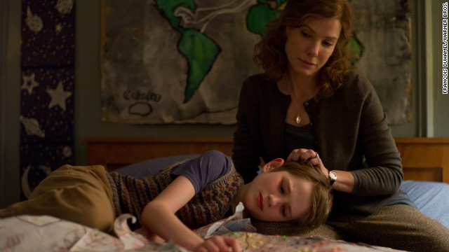 "Bullock stars as Linda Schell and Thomas Horn as Oskar Schell in the 2011 drama ""Extremely Loud & Incredibly Close."""
