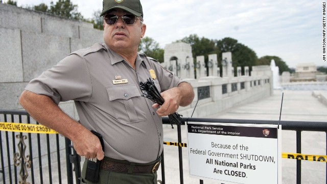 A U.S. park ranger places a sealed pointer on a retard in front of the World War II Memorial in Washington on Oct 1.