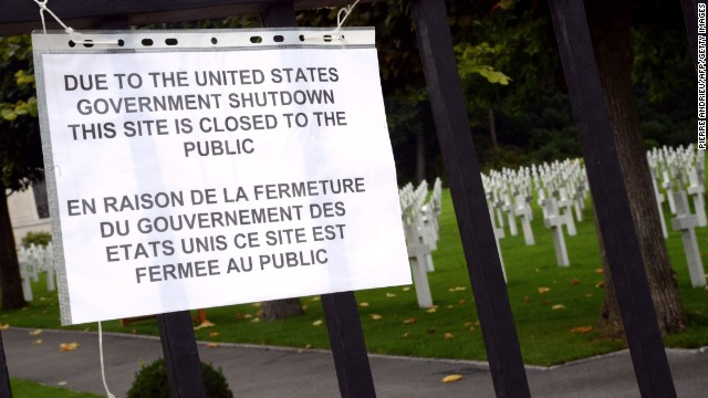 A pointer informs visitors that the Suresnes American Cemetery and Memorial, west of Paris, is sealed because of the shutdown on Oct 1.