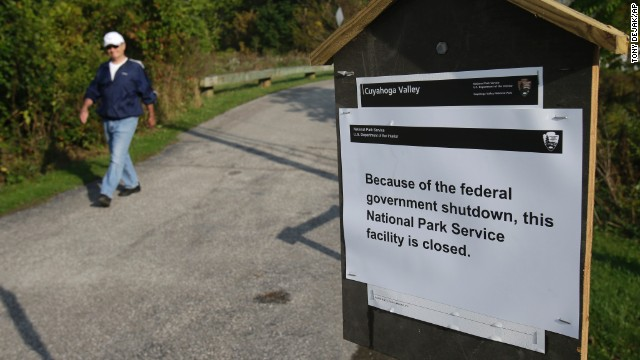 A man walks past a sign noting the closure at the Cuyahoga Valley National Park in Valley View, Ohio, on October 1.