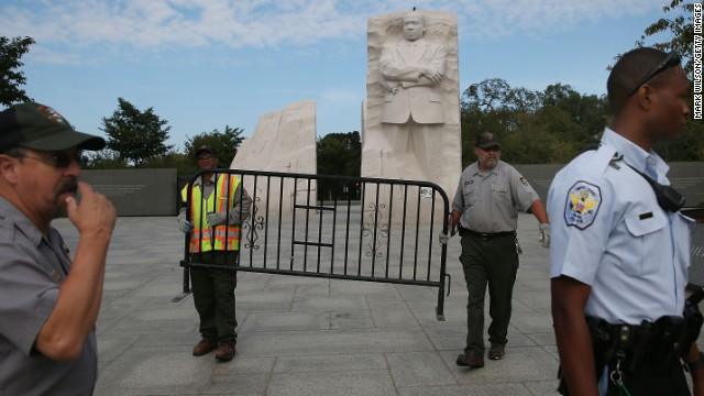 Park military and Park Service employees tighten down the Martin Luther King Jr. Memorial on the National Mall on Oct 1.
