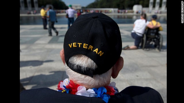 World War II Veteran George Bloss, from Gulfport, Mississippi, looks out over the National World War II Memorial in Washington, on Oct 1. Veterans who had trafficked from opposite the nation were authorised to revisit the National World War II Memorial after it had been strictly sealed because of the prejudiced supervision shutdown.