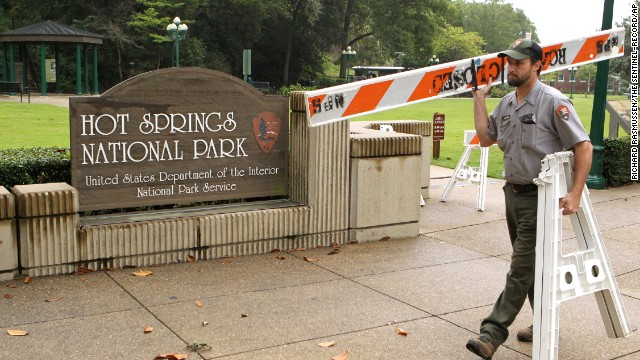 Hot Springs National Park worker Stacy Jackson carries a retard while shutting Arlington Lawn in Hot Springs National Park in Arkansas on Oct 1.