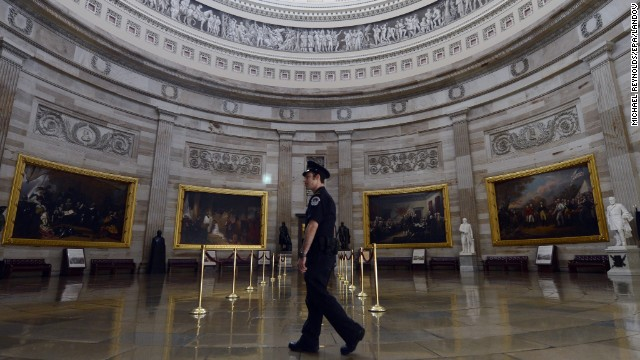 A Capitol military officer walks through the dull Capitol Rotunda, sealed to tours during the supervision shutdown on Capitol Hill in Washington, on Oct 1.