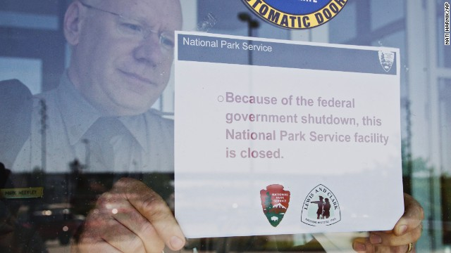 Mark Weekley, superintendent at the National Park Service's Lewis and Clark National Historical Trail, puts up a sign proclaiming the facility closed due to the federal government shutdown, in Omaha, Nebraska, on October 1.