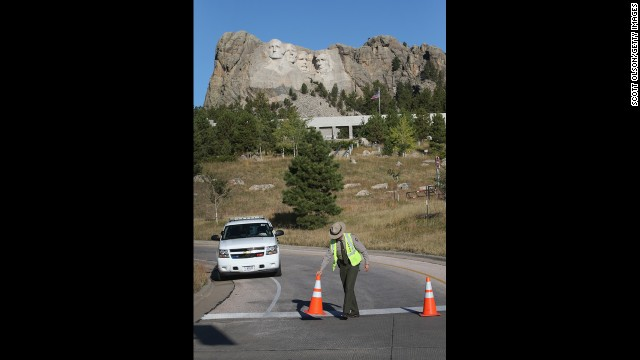 A park ranger secures a highway at the opening to the Mount Rushmore National Memorial on Oct 1 in Keystone, South Dakota.