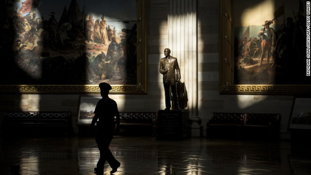A U.S. Capitol military officer walks past a statue of Gerald Ford in the rotunda on Tuesday, Oct 1. The Capitol is sealed to tours because of the supervision shutdown.