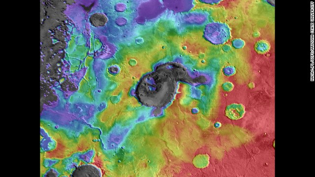 Scientists believe this caldera, Eden Patera, on Mars is an ancient supervolcano. In this image of the caldera, digital-elevation data is overlaid on daytime thermal infrared images. (Red means higher elevations, while purple/gray means lower.) The crater in the middle is about 70 kilometers wide and 1,800 meters deep.