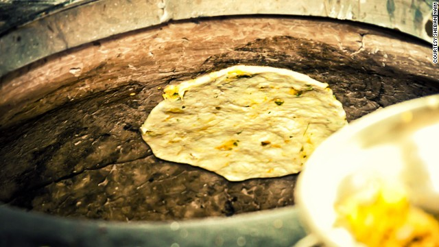 Punjabi stuffed kulchas (breads) are cooked in a traditional tandoor oven.