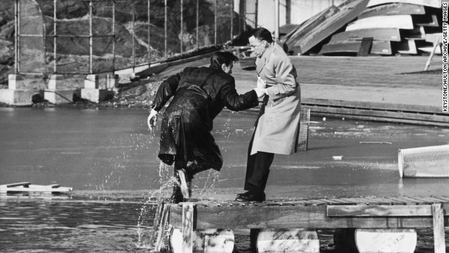 "And if your tastes run toward conspiracy theories, there's always the 1962 thriller ""The Manchurian Candidate."" Here, star Frank Sinatra drags a soaking wet Laurence Harvey from the lake during location filming in Central Park in February 1962."
