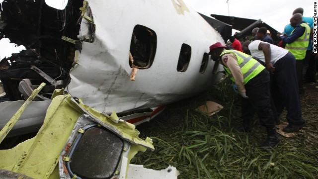 Rescuers peer into the wreckage of a jet at the Lagos airport in Nigeria on Thursday.