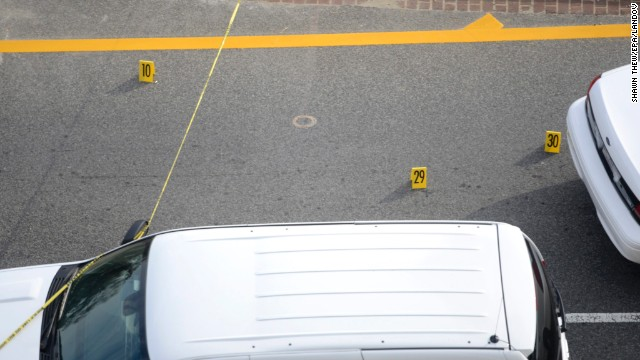 Police evidence markers are placed at the scene outside the U.S. Capitol.<!-- --> </br>