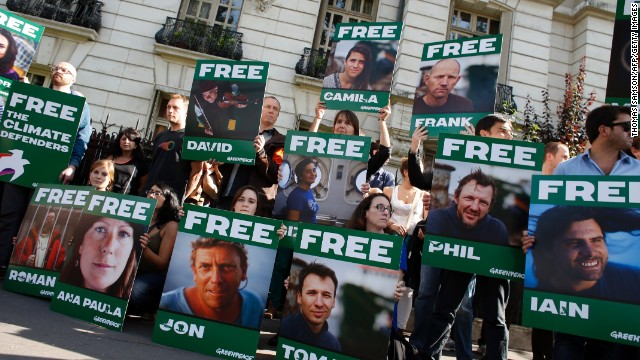 Greenpeace activists protest on September 27 in front of the Russian embassy in Paris.