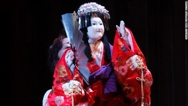A Bunraku puppet performer from Japan.