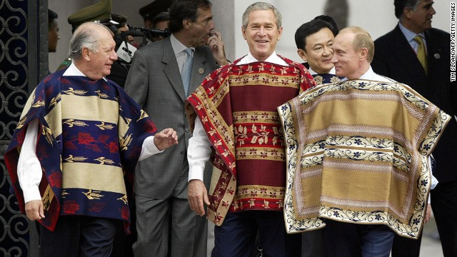 With a jaunty nonchalance in Santiago (2004), George Bush showed a boxed-in Vladimir Putin how to properly fill out a poncho.