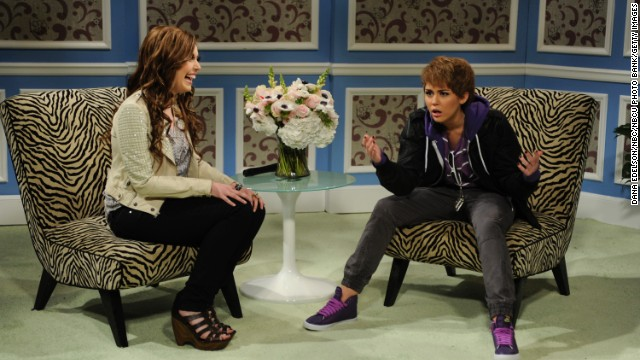 Cyrus impersonates singer Justin Bieber in a Saturday Night Live skit with Vanessa Bayer in March 2011.