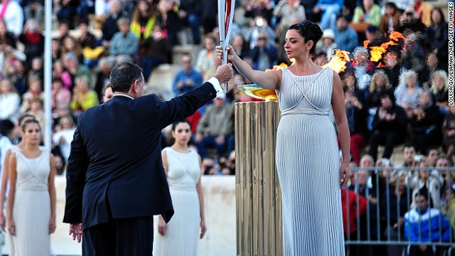 Greece passes Olympic flame to Russia