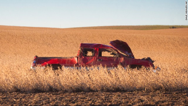 A truck sits in a soybean field in Wayne, Nebraska, on Saturday, October 5 after being thrown there by a tornado. Storms struck the U.S. starting Friday, October 4, causing tornadoes and dumping snow in South Dakota and Wyoming.